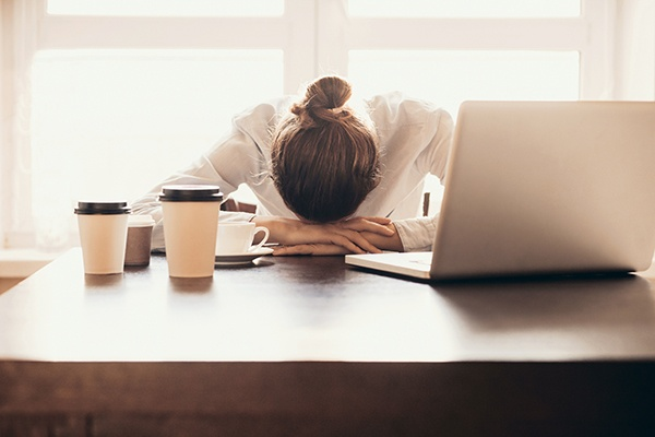 Tired employee at her desk